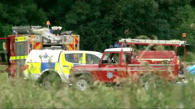 pilot of vintage aircraft killed at old warden aerodrome air display; england: bedfordshire: biggleswade: old warden aerodrome: ext fire engines and... - on air sign stock videos & royalty-free footage
