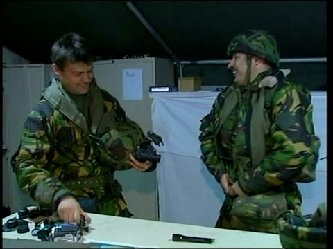 stockvideo's en b-roll-footage met raf pilot pool kuwait int helmets laid out in line on table track wing commander chris norton putting on flight suit joking with fellow pilot as... - houten paal