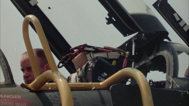 1967 cu pilot preparing, sitting in fighter jet airplane - pilot stock videos & royalty-free footage