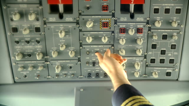 Pilot pushing buttons.