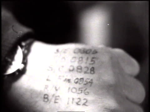 pilot sitting in the cockpit of a plane / hand with coordinates written on the back - 1944 stock videos and b-roll footage