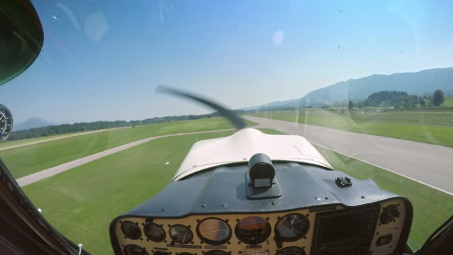 pov pilot taking off in the light aircraft in sunshine - propeller stock videos & royalty-free footage