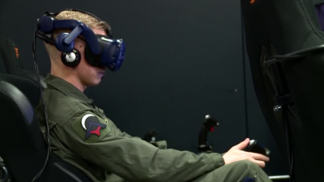 pilot training with virtual reality flight simulator at armed forces reserve center in austin, texas. - cyberspace stock videos & royalty-free footage