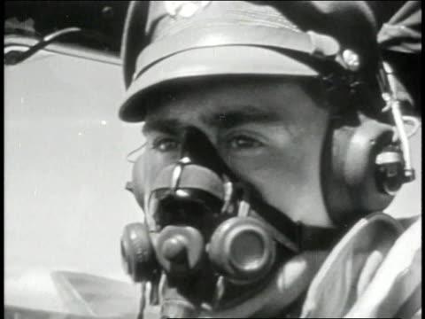 pilot wearing oxygen mask / gunner scanning sky / planes flying / - einige gegenstände mittelgroße ansammlung stock-videos und b-roll-filmmaterial