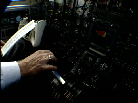 a pilot works the throttle in a cockpit. - cockpit stock videos & royalty-free footage