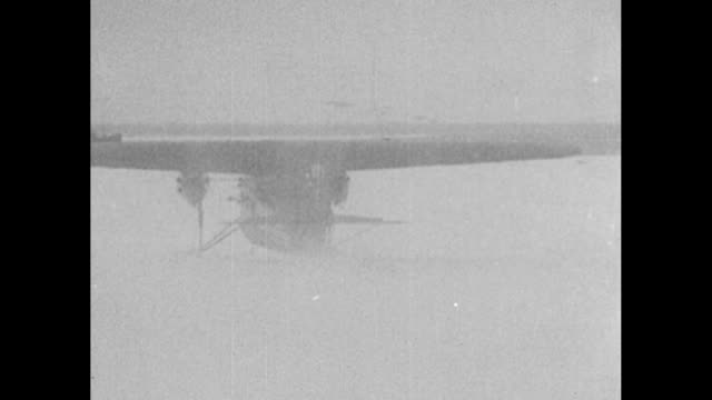 [1926] pilots admiral richard e byrd and floyd bennett get into airplane on norwegian island of spitsbergen for flight over north pole / plane takes... - exploration stock videos & royalty-free footage