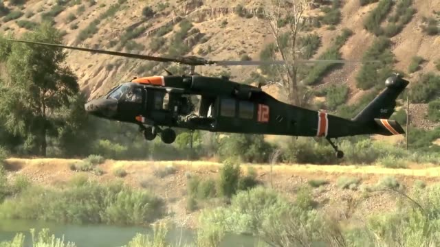 pilots and crew chiefs from 2nd battalion 211th aviation regiment utah national guard assist in firefighting efforts near morgan utah on july 23rd... - battalion stock videos and b-roll footage