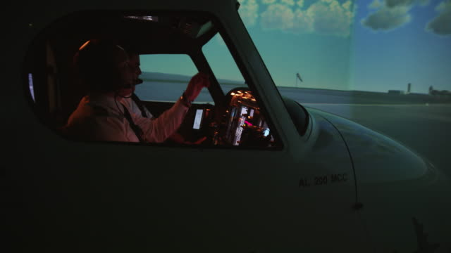 TS WS pilots and instructor in professional flight simulator, external view, RED R3D 4K