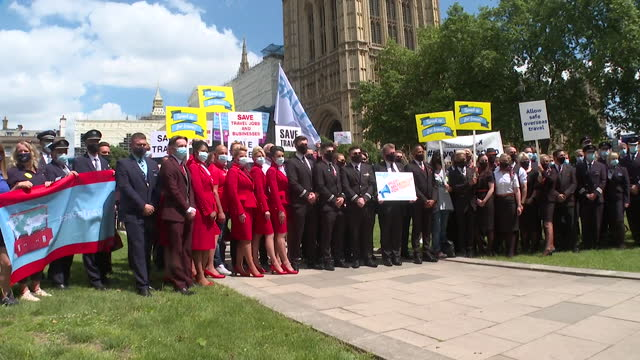 pilots, cabin crew and travel agents protesting outside houses of parliament over government travel restrictions during coronavrius pandemic, having... - image effect stock videos & royalty-free footage