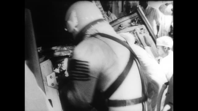 pilots charles conrad and richard gordon are greeted by crew on top of the titan ii rocket / men are helped into their space capsules / both men... - control stock videos & royalty-free footage