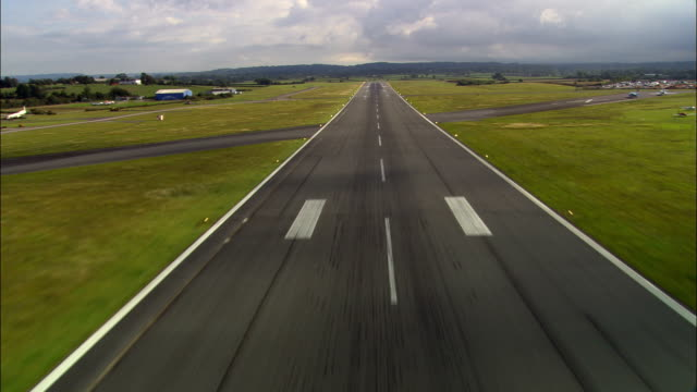 pilots eye view of take off  - aerial view - england, devon, east devon district, united kingdom - runway stock videos & royalty-free footage