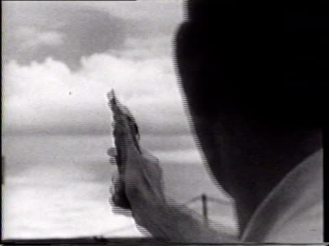 vidéos et rushes de target practice vs pilots firing hand guns on deck practicing ms pilot reloading pistol smiling lieutenant virgil jackson standing next to lieutenant... - marin