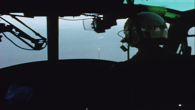 pilots flying helicopter over mekong delta and lsd underway / vietnam - mekong delta stock videos & royalty-free footage