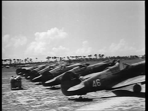 stockvideo's en b-roll-footage met b/w 1942 pilots get into parked fighter planes on airfield / flying tigers curtiss p40b warhawks - middelgrote groep dingen