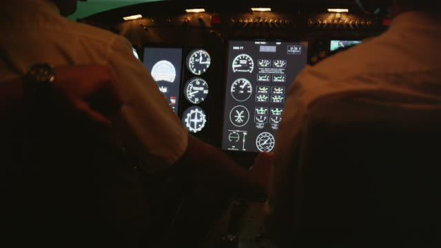 CU pilots' hands and instruments in professional flight simulator, RED R3D 4K