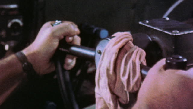 CU Pilot's hands steering B29 in flight with silk stockings draped over wheel