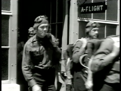 pilots in gear exiting building sign 'aflight' bg ha ws pilots walking to lined up w/ twoman fighter airplanes ws two pilots standing at attention in... - us air force stock videos & royalty-free footage