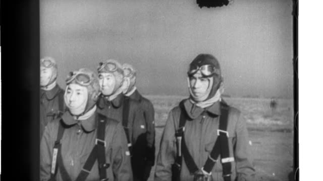 pilots of the manchurian air forces form lines at the hshinking airport; manchurian air force pilots board type 97 fighters and take off one by one. - manchuria region stock videos & royalty-free footage