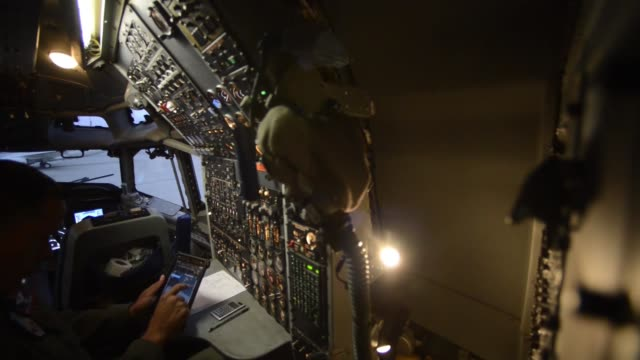 pilots prepare an an e3 sentry airborne warning and control system aircraft to provide air surveillance command and control and communication... - position stock-videos und b-roll-filmmaterial