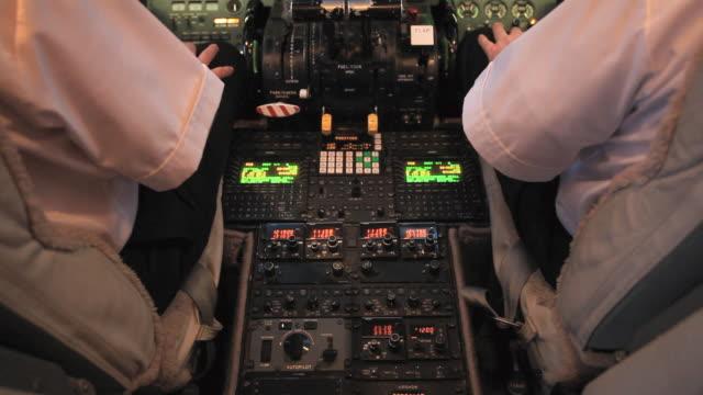 MS TU Pilots talking inside corporate jet at airport / Salt Lake City, Utah, USA