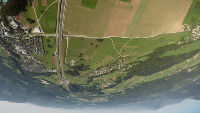 pov pilot's view from the plane he is turning upside down above the countryside - upside down stock videos and b-roll footage