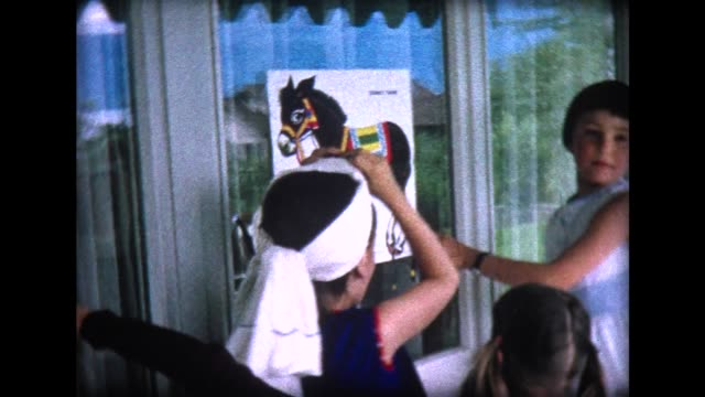 1965 pin the tail on the donkey at birthday party - blindfold stock videos and b-roll footage