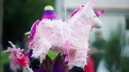 A pinata in the form of horses hanging on the rope