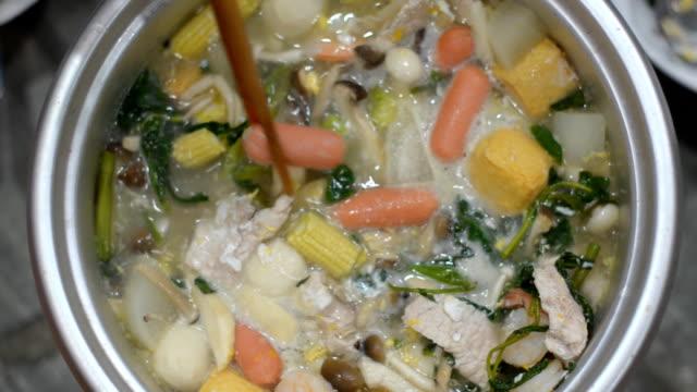 pinch meat in sukiyaki with chopsticks - pinching stock videos & royalty-free footage