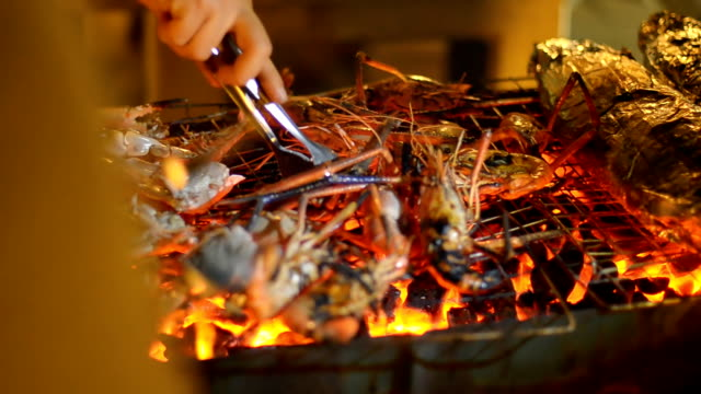 pinching shrimp and fish on barbecue at night - pinching stock videos & royalty-free footage