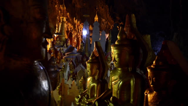 pindaya grotto buddhist shrine, myanmar - male likeness stock videos & royalty-free footage