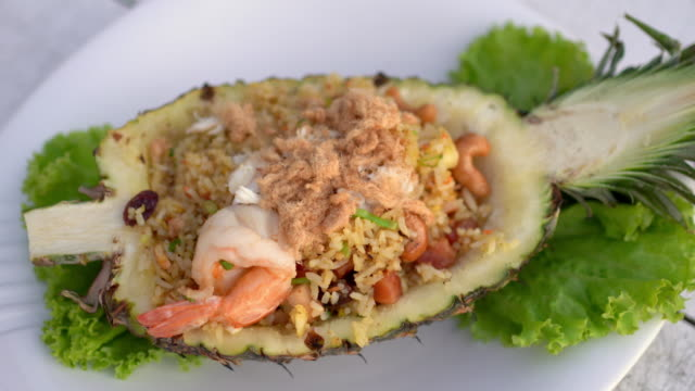 4k pineapple fried rice, dolly out shot - hawaiian culture stock videos & royalty-free footage