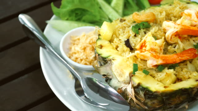 pan pineapple fried rice, thai food - fried rice stock videos and b-roll footage