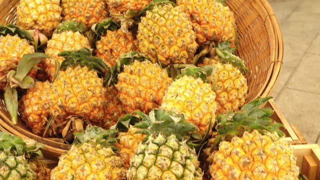 Pineapples in market Tilt up shot