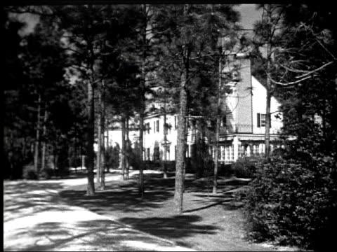pinehurst village chapel church the pinehurst theatre many cars on village streets houses mansions and residences of golfers pinehurst resort hotel... - tourist resort stock videos & royalty-free footage
