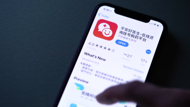 vídeos de stock, filmes e b-roll de ping an good doctor application landing screen and icon are displayed on an apple inc iphone in hong kong china on wednesday may 2 2018 - dedo humano
