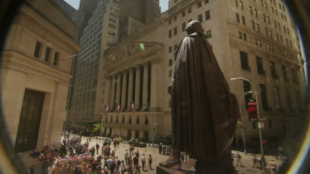 a pinhole view time lapse of new york stock exchange and george washington statue - george washington stock videos and b-roll footage
