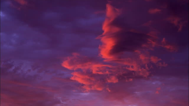 Pink and purple clouds fill the sky.