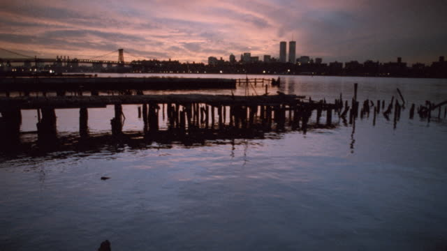 a pink and purple sky glows above the hudson river near new york city. - 2001 stock videos & royalty-free footage