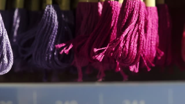pink and purple threads for sewing patchwork project in the workshop, handmade and handicraft concept. - patchwork stock videos & royalty-free footage