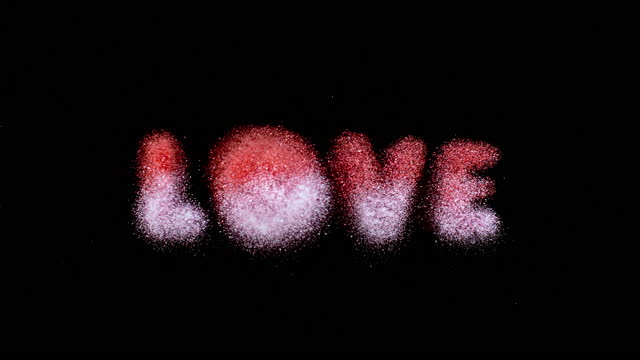 """slo mo ld pink and red dust falling onto a surface and creating an inscription """"love"""" - western script stock videos & royalty-free footage"""