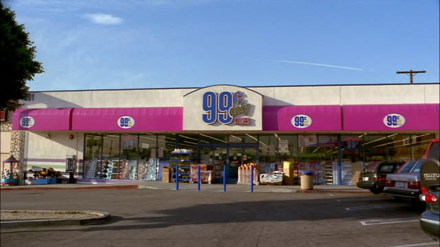 a pink awning advertises a ninety-nine cent store in los angeles, california. - awning stock videos & royalty-free footage