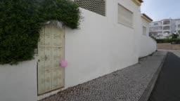 A Pink Balloon Outside Apartment 5a On Rua Dr Agostinho Da Silva