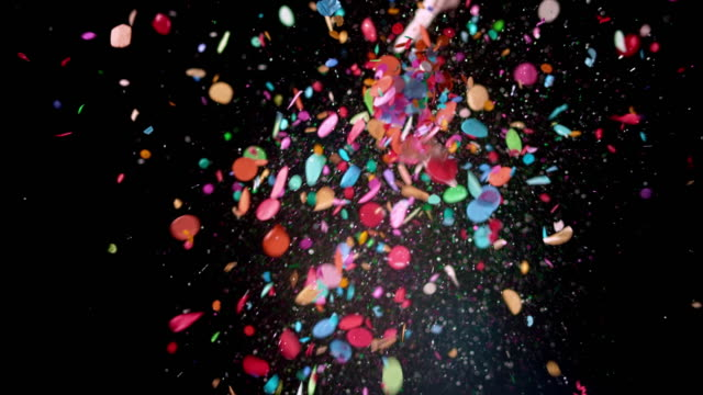 slo mo ld pink balloon popping and releasing confetti into the air - colour image stock videos & royalty-free footage