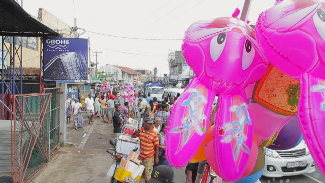 ms td pink bunnies on stick and crowds going home after seenigama annual perahera parade is finished / sinigama, southern province, sri lanka - sri lankan culture stock videos & royalty-free footage