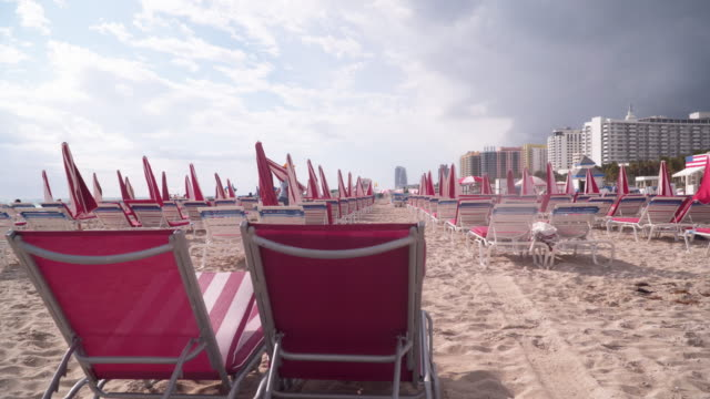 Pink chairs on Miami beach, tracking shot