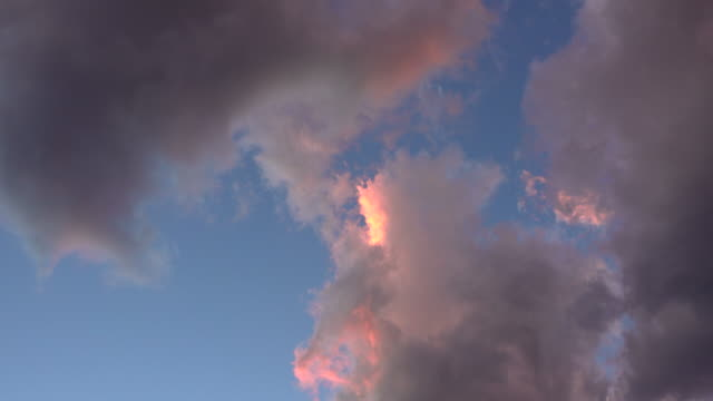 Pink clouds in blue sky