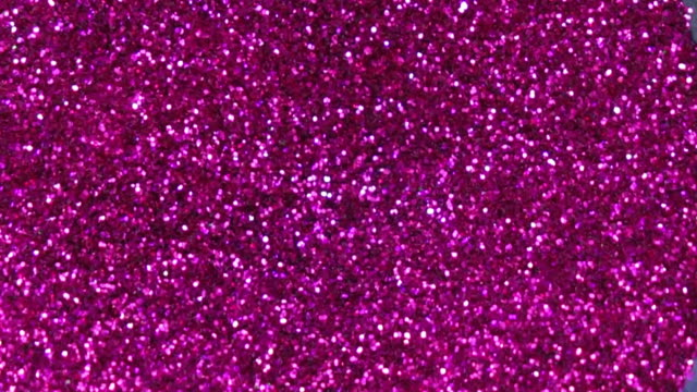 pink colored explosion slow motion - scintillante video stock e b–roll