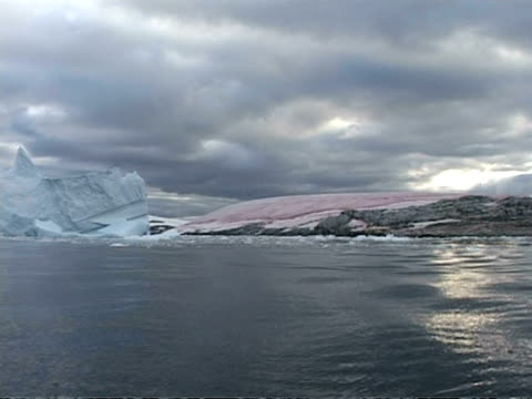 wa pink dimpled ice formation, yellow & grey clouds, antarctica - algae stock videos & royalty-free footage