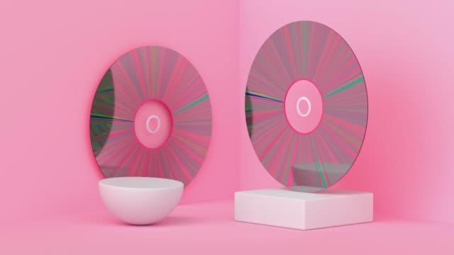 vídeos de stock, filmes e b-roll de movimento abstrato de disco rosa 3d renderização - dvd cd