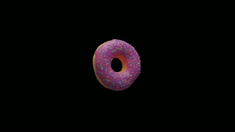 vídeos de stock, filmes e b-roll de donut rosa flutuando no ar com canal alpha - um único objeto